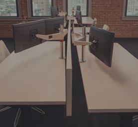a flexible office setup with multiple height adjustable desks