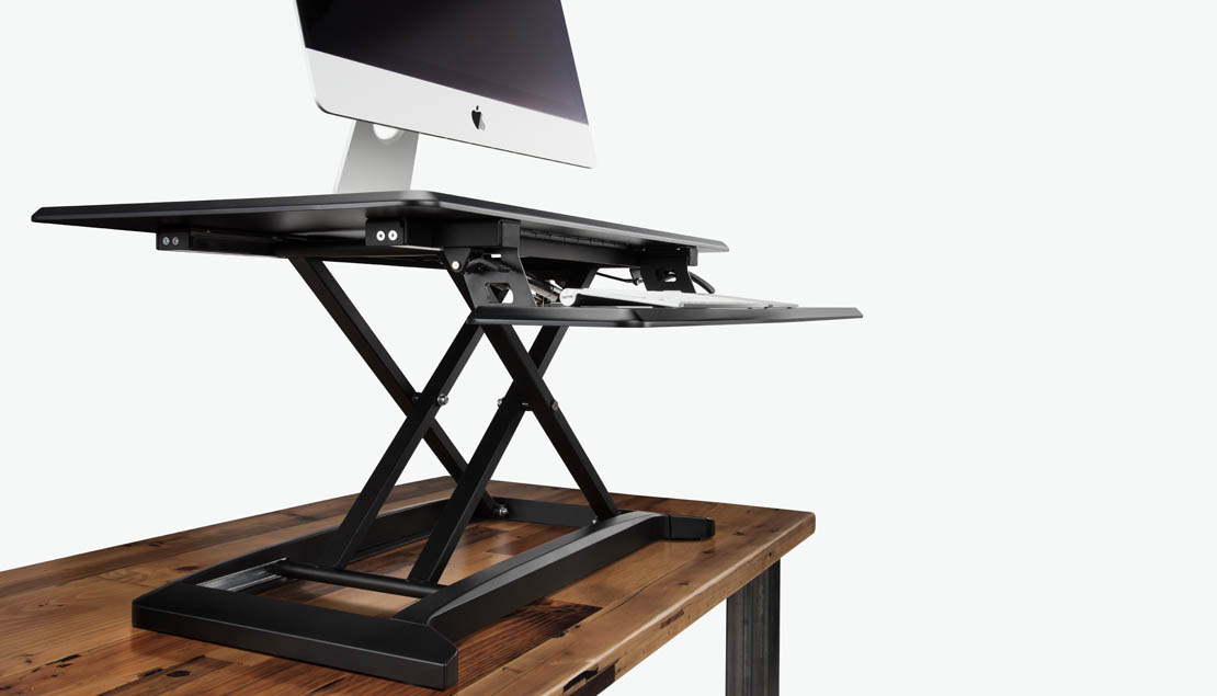 standing desk converters sit on your existing office desk